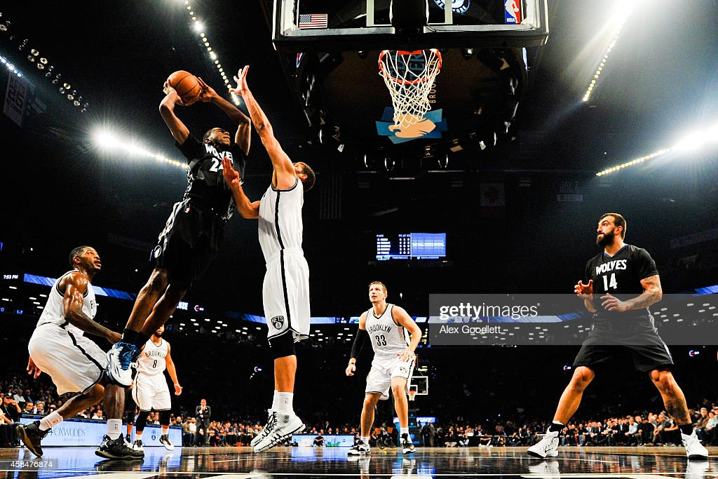 Andrew Wiggins #22 of the Minnesota Timberwolves attempts a shot against Brook Lopez #11 of the Brooklyn Nets in the first half at the Barclays Center on November 5, 2014 in the Brooklyn borough of New York City.