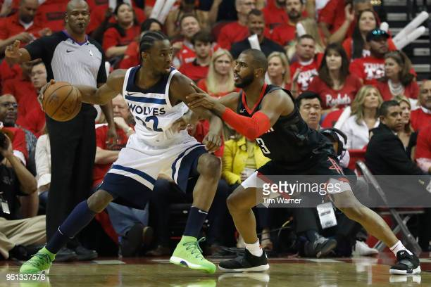 Andrew Wiggins of the Minnesota Timberwolves controls the ball defended by Chris Paul of the Houston Rockets in the first half during Game Five of...