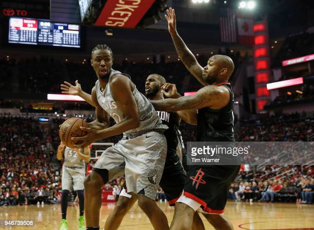 Andrew Wiggins of the Minnesota Timberwolves controls the ball defended by PJ Tucker of the Houston Rockets and Chris Paul in the second half during...