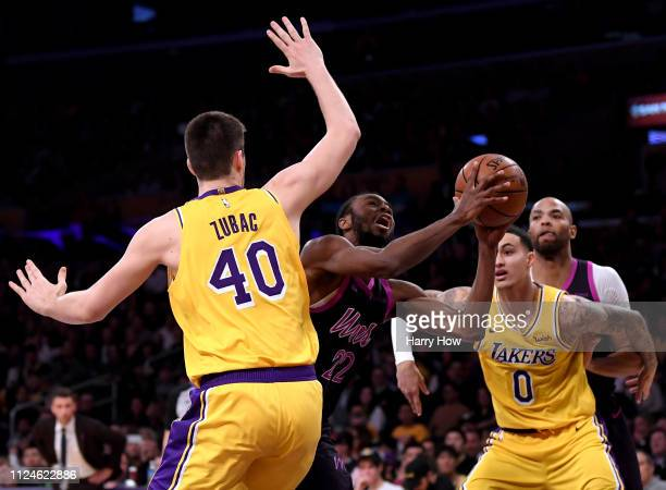 Andrew Wiggins of the Minnesota Timberwolves drives on Ivica Zubac of the Los Angeles Lakers during the first half at Staples Center on January 24...