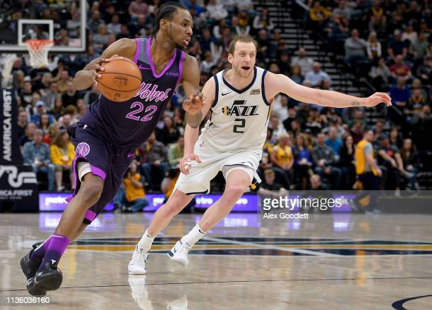Andrew Wiggins of the Minnesota Timberwolves drives past Joe Ingles of the Utah Jazz during a game at Vivint Smart Home Arena on March 14 2019 in...