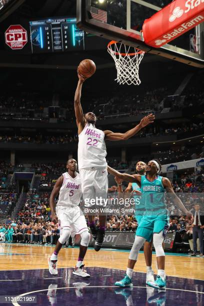 Andrew Wiggins of the Minnesota Timberwolves drives through the paint during the game against Malik Monk of the Charlotte Hornets on March 21 2019 at...