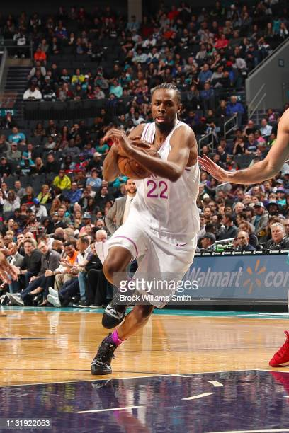 Andrew Wiggins of the Minnesota Timberwolves drives through the paint during the game against Willy Hernangomez of the Charlotte Hornets on March 21...