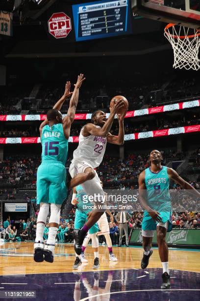 Andrew Wiggins of the Minnesota Timberwolves drives to the basket during the game against Kemba Walker of the Charlotte Hornets on March 21 2019 at...