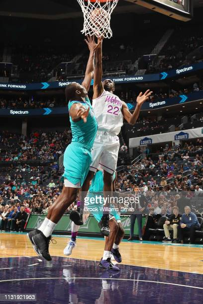 Andrew Wiggins of the Minnesota Timberwolves drives to the basket during the game against Bismack Biyombo of the Charlotte Hornets on March 21 2019...