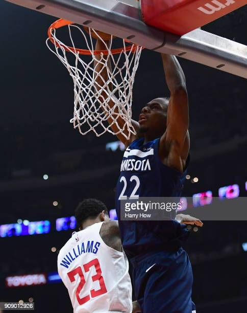 Andrew Wiggins of the Minnesota Timberwolves dunks over Lou Williams of the LA Clippers during the first half at Staples Center on January 22 2018 in...