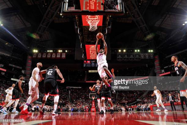 Andrew Wiggins of the Minnesota Timberwolves dunks the ball against the Houston Rockets on March 17 2019 at the Toyota Center in Houston Texas NOTE...