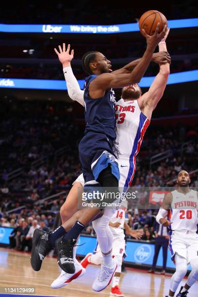 Andrew Wiggins of the Minnesota Timberwolves gets to the basket past Blake Griffin of the Detroit Pistons during the first half at Little Caesars...