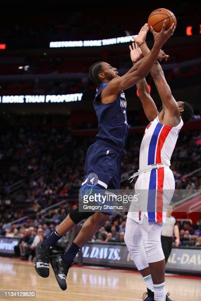Andrew Wiggins of the Minnesota Timberwolves gets to the basket past Andre Drummond of the Detroit Pistons during the first half at Little Caesars...