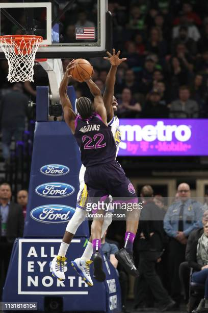 Andrew Wiggins of the Minnesota Timberwolves goes to the basket against Draymond Green of the Golden State Warriors on March 19 2019 at Target Center...