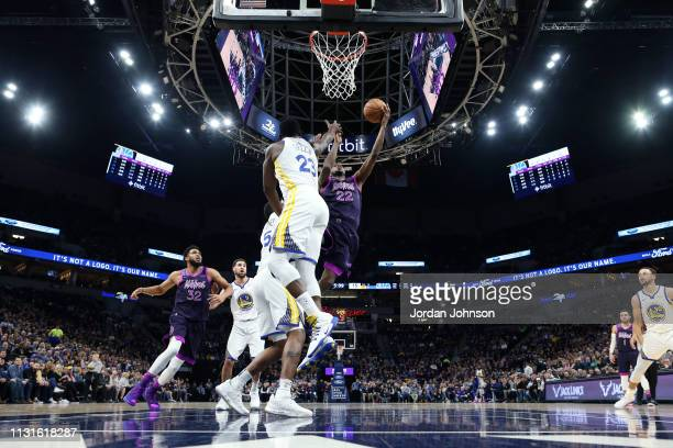 Andrew Wiggins of the Minnesota Timberwolves goes to the basket against the Golden State Warriors on March 19 2019 at Target Center in Minneapolis...