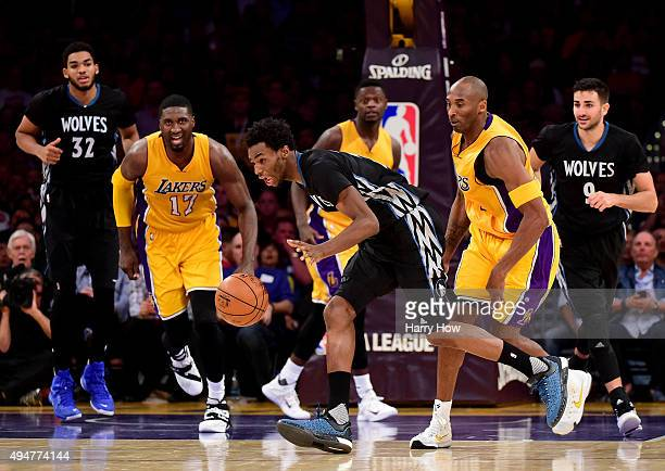 Andrew Wiggins of the Minnesota Timberwolves grabs possessoin of a rebound in front of Kobe Bryant of the Los Angeles Lakers during a 112111...
