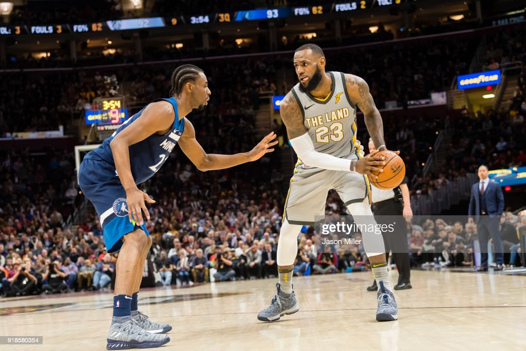 334e42cd400d Andrew Wiggins of the Minnesota Timberwolves guards LeBron James of ...