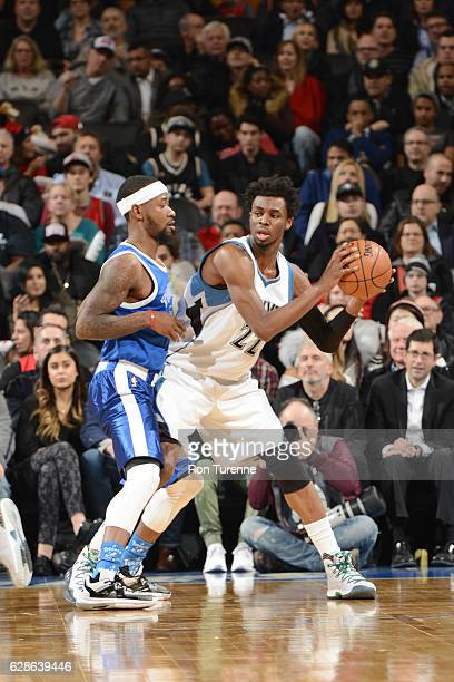 Andrew Wiggins of the Minnesota Timberwolves handles the ball against Terrence Ross of the Toronto Raptors during the game on December 8 2016 at the...