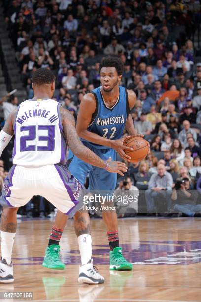 Andrew Wiggins of the Minnesota Timberwolves handles the ball against Ben McLemore of the Sacramento Kings on February 27 2017 at Golden 1 Center in...