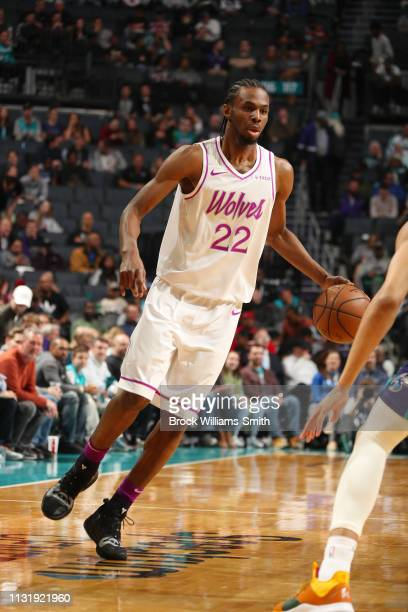 Andrew Wiggins of the Minnesota Timberwolves handles the ball during the game against the Charlotte Hornets on March 21 2019 at Spectrum Center in...