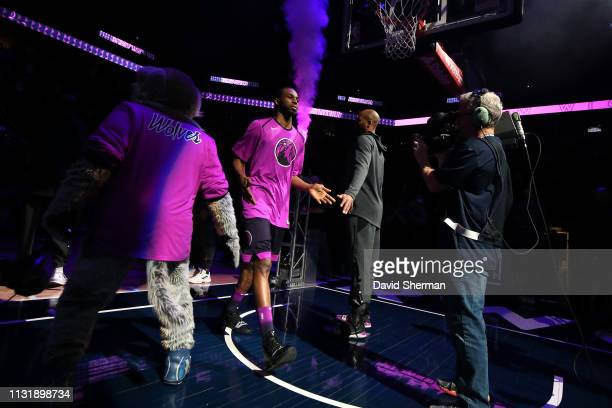 Andrew Wiggins of the Minnesota Timberwolves hifives teammates as he enters the court on March 19 2019 at Target Center in Minneapolis Minnesota NOTE...