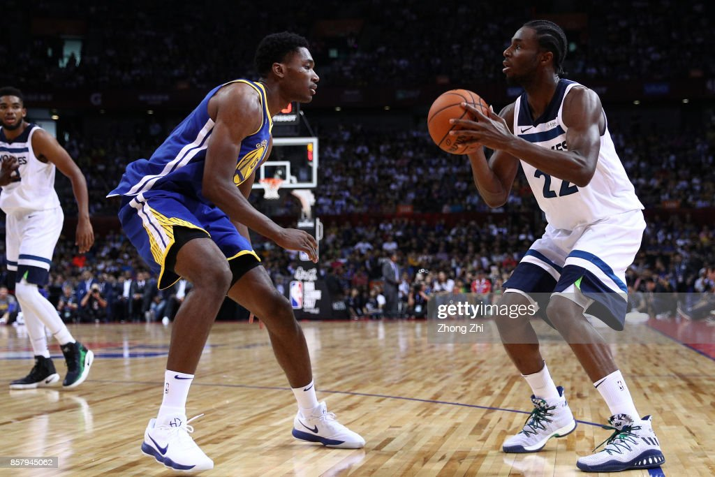Andrew Wiggins #22 of the Minnesota Timberwolves in action against Damian Jones #15 of the Golden State Warriors during the game between the Minnesota Timberwolves and the Golden State Warriors as part of 2017 NBA Global Games China at Universidade Center on October 5, 2017 in Shenzhen, China.