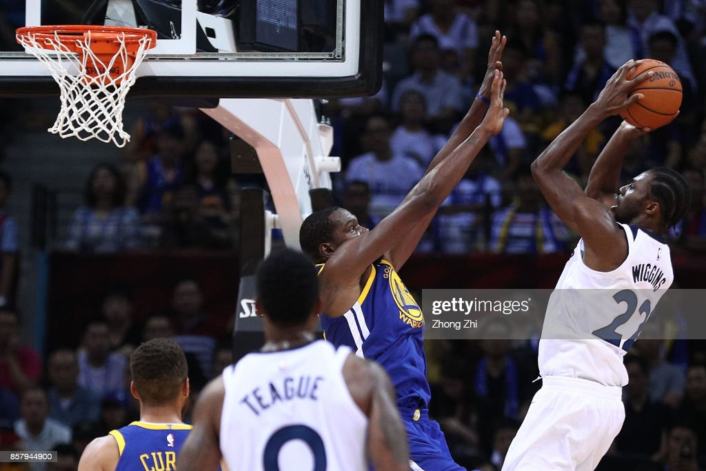 Andrew Wiggins #22 of the Minnesota Timberwolves in action against Kevin Durant #35 of the Golden State Warriors during the game between the Minnesota Timberwolves and the Golden State Warriors as part of 2017 NBA Global Games China at Universidade Center on October 5, 2017 in Shenzhen, China.