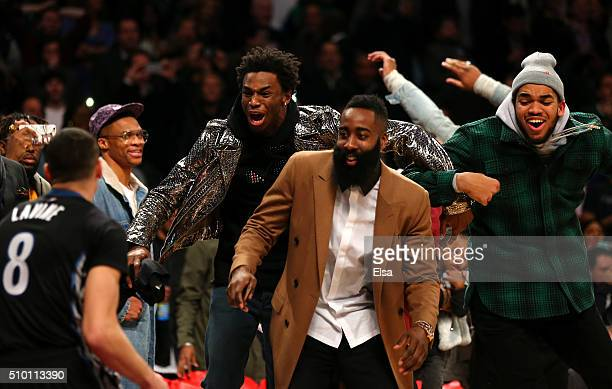 Andrew Wiggins of the Minnesota Timberwolves James Harden of the Houston Rockets and KarlAnthony Towns of the Minnesota Timberwolves react after a...