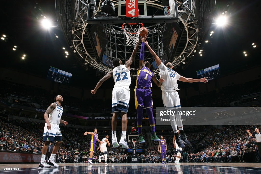 Andrew Wiggins #22 of the Minnesota Timberwolves Kentavious Caldwell-Pope #1 of the Los Angeles Lakers and Taj Gibson #67 of the Minnesota Timberwolves reach for the ball during the game between the two teams on February 15, 2018 at Target Center in Minneapolis, Minnesota.