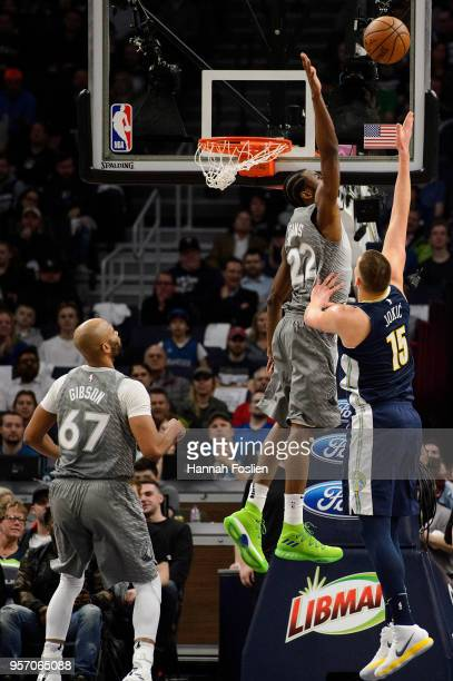 Andrew Wiggins of the Minnesota Timberwolves looks to blocks a shot by Nikola Jokic of the Denver Nuggets during the game on April 11 2018 at the...