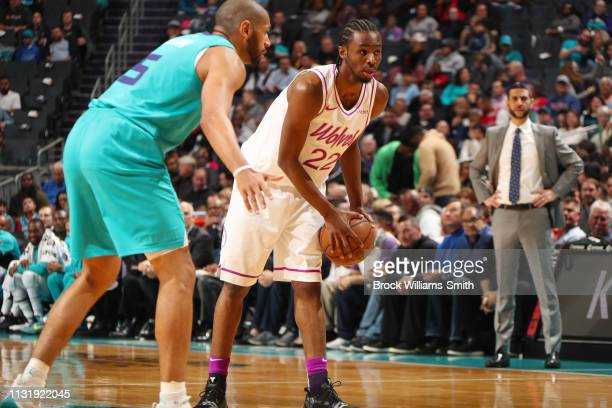 Andrew Wiggins of the Minnesota Timberwolves looks to pass the ball during the game against Nicolas Batum of the Charlotte Hornets on March 21 2019...