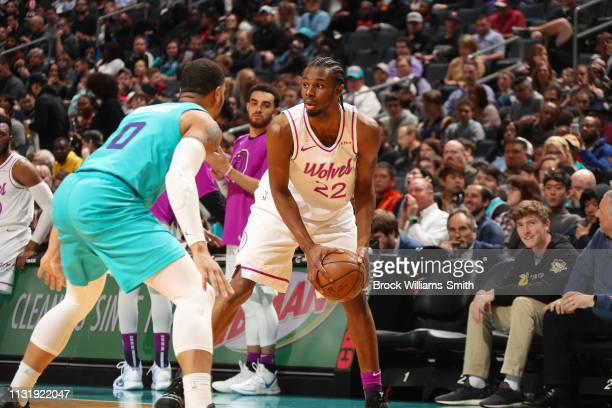 Andrew Wiggins of the Minnesota Timberwolves looks to pass the ball during the game against Miles Bridges of the Charlotte Hornets on March 21 2019...