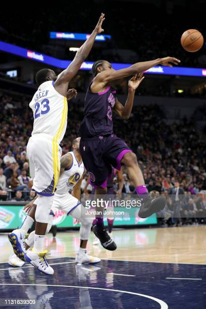 Andrew Wiggins of the Minnesota Timberwolves passes the ball against the Golden State Warriors on March 19 2019 at Target Center in Minneapolis...