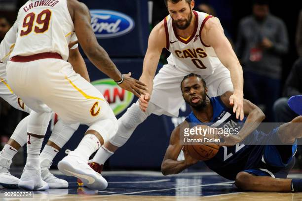 Andrew Wiggins of the Minnesota Timberwolves passes the ball away from Jae Crowder and Kevin Love of the Cleveland Cavaliers during the game on...