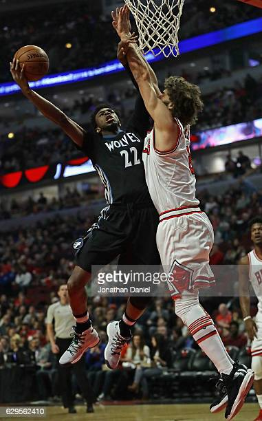 Andrew Wiggins of the Minnesota Timberwolves puts up a shot against Robin Lopez of the Chicago Bulls at the United Center on December 13 2016 in...