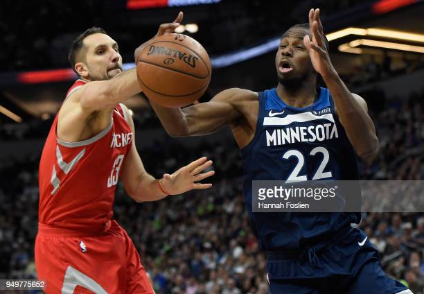 Andrew Wiggins of the Minnesota Timberwolves rebounds the ball against Ryan Anderson of the Houston Rockets during the second quarter in Game Three...