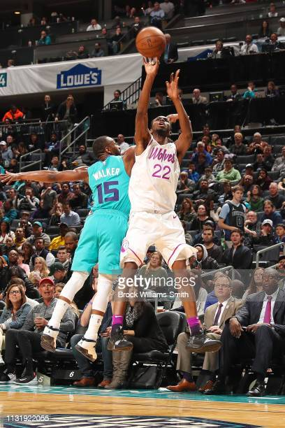 Andrew Wiggins of the Minnesota Timberwolves shoots a threepointer during the game against Kemba Walker of the Charlotte Hornets on March 21 2019 at...