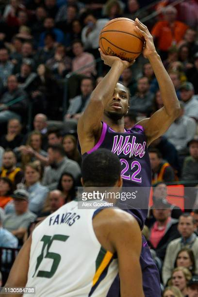 Andrew Wiggins of the Minnesota Timberwolves shoots over Derrick Favors of the Utah Jazz during a game at Vivint Smart Home Arena on March 14 2019 in...