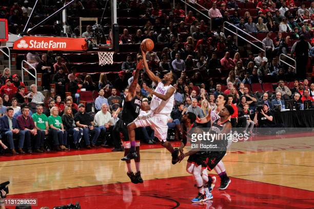 Andrew Wiggins of the Minnesota Timberwolves shoots the ball against the Houston Rockets on March 17 2019 at the Toyota Center in Houston Texas NOTE...