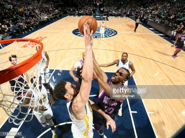 Andrew Wiggins of the Minnesota Timberwolves shoots the ball against Klay Thompson of the Golden State Warriors on March 19 2019 at Target Center in...