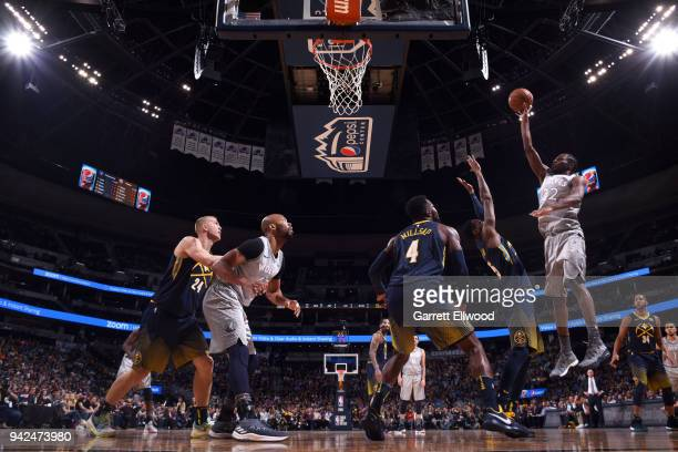 Andrew Wiggins of the Minnesota Timberwolves shoots the ball against the Denver Nuggets on April 5 2018 at the Pepsi Center in Denver Colorado NOTE...
