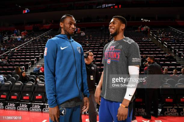Andrew Wiggins of the Minnesota Timberwolves smiles with Bruce Brown of the Detroit Pistons before the game on March 6 2019 at Little Caesars Arena...