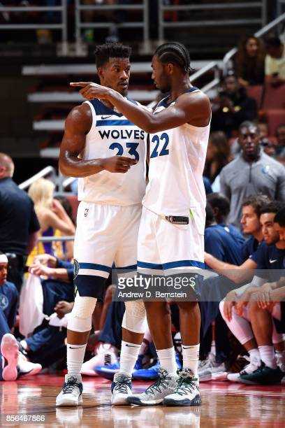 Andrew Wiggins talks with Jimmy Butler of the Minnesota Timberwolves during the game against the Los Angeles Lakers during the preseason game on...
