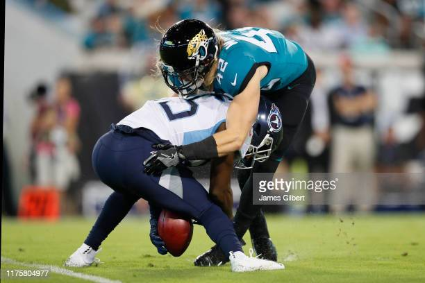 Andrew Wingard of the Jacksonville Jaguars forces a fumble by Adoree' Jackson of the Tennessee Titans during a punt return in the first quarter of a...