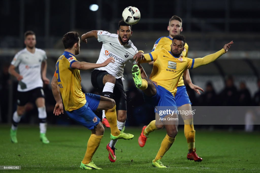 Andrew Wooten (C) of Sandhausen is challenged by Ken Reichel (L) and Phil Ofosu-Ayeh of Braunschweig during the Second Bundesliga match between SV Sandhausen and Eintracht Braunschweig at Hardtwaldstadion on February 24, 2017 in Sandhausen, Germany.