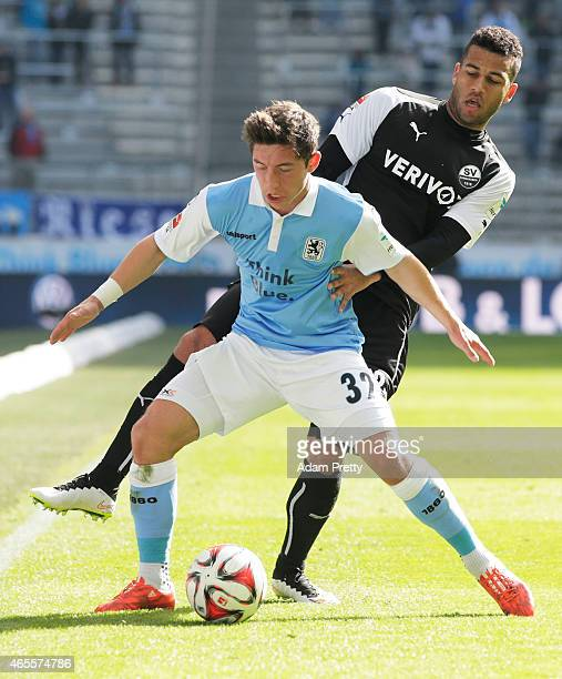 Andrew Wooten of SV Sandhausen is challenges Maximilian Wittek of 1869 Muenchen during the 2 Bundesliga match between 1860 Muenchen and SV Sandhausen...
