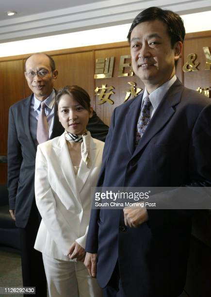 Andrew Wu, Diys Chau and Kevin Wong of Ernst & Young, pictured in their ofice in Gateway Tower, Tsim Sha Tsui. 18 September 2003