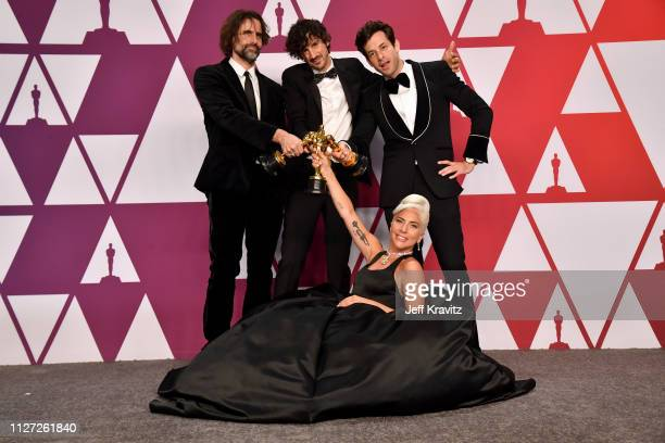 Andrew Wyatt Anthony Rossomando Lady Gaga and Mark Ronson pose with the Best Original Song award for Shallow in the press room during at Hollywood...