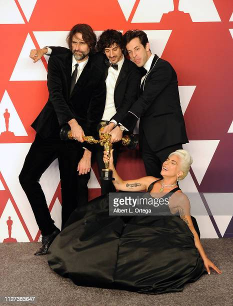 Andrew Wyatt Anthony Rossomando Mark Ronson and Lady Gaga pose with their award for Best Original Song 'Shallow' inside the Press Room at the 91st...