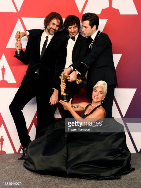 Andrew Wyatt Anthony Rossomando Mark Ronson and Lady Gaga winners of Best Original Song for Shallow from A Star is Born pose in the press room during...