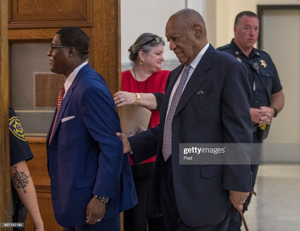Andrew Wyatt, left, guides Bill Cosby, center, into Courtroom A at the Montgomery County Courthouse August 22, 2017 in Norristown, Pennsylvania. Bill Cosby and his new lawyers will have a hearing in Montgomery County Court about dropping his old counsel, adding his new counsel and if the jury pool will be taken out of county again.