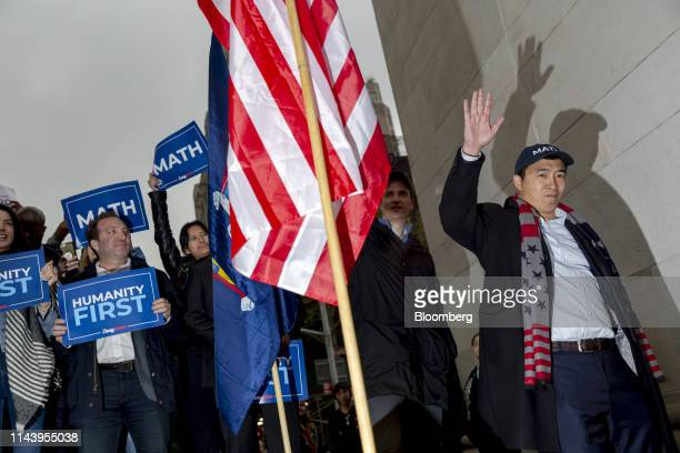 Andrew Yang founder of Venture for America and 2020 Democratic presidential candidate waves during a campaign rally in New York US on Tuesday May 14...