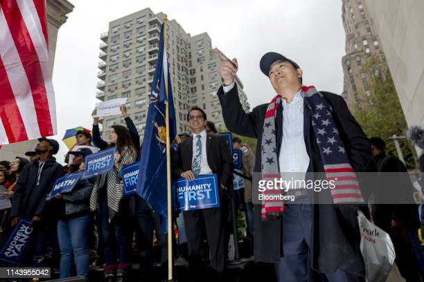 Andrew Yang founder of Venture for America and 2020 Democratic presidential candidate gestures during a campaign rally in New York US on Tuesday May...