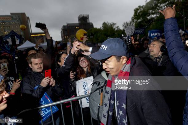 Andrew Yang founder of Venture for America and 2020 Democratic presidential candidate greets supporters during a campaign rally in New York US on...